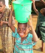 Malawian boy and bucket